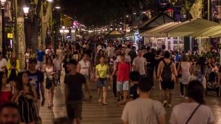 BARCELONA, SPAIN - CIRCA JULY 2016: Timelapse while people walk on La Rambla street.