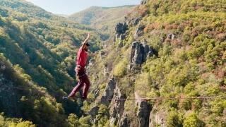 Brave Young Man Slacklining Above Mountains During Autumn Season Tree Nature Adventure Sport Danger Hiker Walking Balance Extreme Performance Sunny Leisure