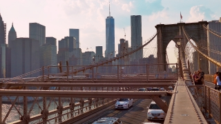 NEW YORK, USA - CIRCA JULY 2016: Brooklyn Bridge traffic passes in front of Manhattan skyline.