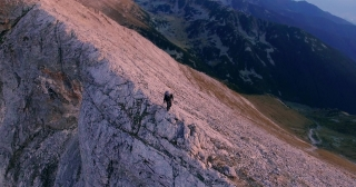 Drone Footage Of Man Climbing On Top Of Mountain Hiking Adventure Sunset Nature Extreme Sport Aerial Freedom Lifestyle Beautiful Walking Challenge