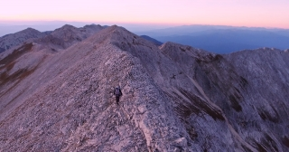 Drone Footage Of Hiker Climbing On Top Of Mountain Adventure Nature Extreme Sport Aerial Sunset Freedom Beautiful Walking Lifestyle Challenge Scenic Steep