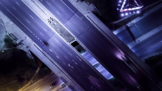 Aerial Footage Of Motor Vehicles On Bridge At Night Drone Freeway Traffic City Timelapse Motion Modern Car Transportation Los Angeles Metropolis