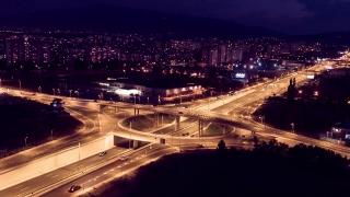 Interchange Overpass And Elevated Road In Night Time Lapse Traffic Freeway Downtown Aerial Drone Skyline Metropolitan Futuristic Interchange