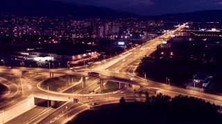 Drone Footage Of Illuminated City And Elevated Road At Night Car Traffic Transportation Rush Curve Aerial Junction Timelapse  Congestion
