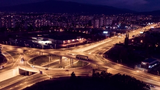 Illuminated City And Interchange Overpass At Night Aerial Drone Highway  Traffic Freeway Flyover Junction Transportation Metropolis Roundabout
