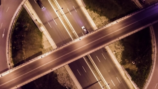 Drone Footage Of Interchange  At Night Traffic Freeway Car Bridge Rush Junction Time Lapse Elevated Road Metropolis