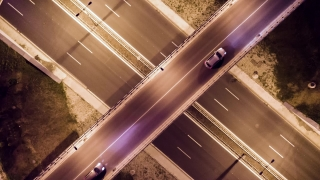 Elevated Road Junction And Interchange Overpass At Night City Transportation Aerial Drone Bridge Vehicle Rush Metropolis Time Lapse