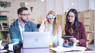 Creative Innovative Coworkers Team Testing Woman Wearing Vr AR Headset 3D Virtual Reality Writing Data Developing Future Technology Designing Augmented Reality Applications
