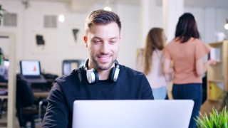 Trendy Young Businessman Looking At A Laptop Planning Happy Office Creative Environment Slow Motion 4K Shot On Red Epic 8K