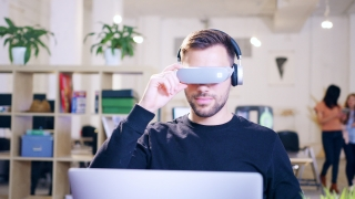 Young Businessman Wearing VR Glasses Working on Virtual HUD Display Hologram Futuristic Workplace Technology Ocolus Shot On Red Epic 8K
