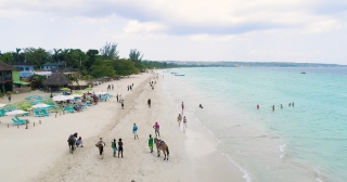 Aerial Flying Over Beautiful Caribbean Blue Sea Beach Jamaican Nature Landscape Exotic Island Tourism Tourism And Travel Concept Slow Motion 4k