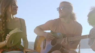 Group Of Happy Friends Playing Guitar And Singing Around Forest Camp Fire Clapping Drinking Laughing And Joking Music And Happiness In The Wild Happiness In Nature Concept Slow Motion Shot On Red Epic
