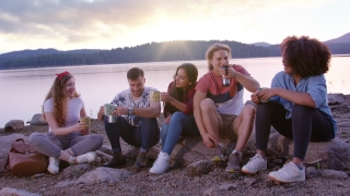Diverse Group Of Attractive Young People Sitting And Laughing On Lake Shore Beautiful Sunrise Sunset Morning Drinking Coffee Vacation In Nature Concept Slow Motion Shot On Red Epic W 8k