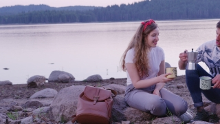 Group Of Happy Friends Sitting In Nature On Lake Beach Smiling And Pouring Coffee Friendship And Happiness In The Wild Romantic Getaway Concept Slow Motion Shot On Red Epic W 8k