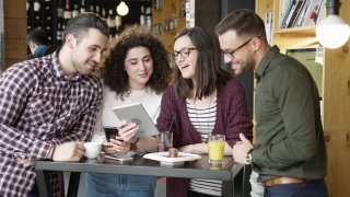Diverse Group Pretty Friends Laughing At  Funny Video Meme Studying Holding A Tablet At Cafe Smiling Trendy Coworkers Discussing A Project Slow Motion Shot On Red Epic 8K