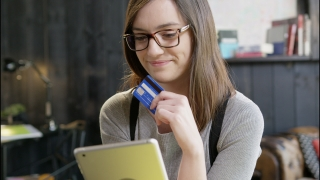 Smart Young Girl With Glasses Holding An iPad And Credit Card Deciding To Make Online Purchase Decision Making Online Ecommerce App Store Concept Slow Motion Shot On Red Epic 8K