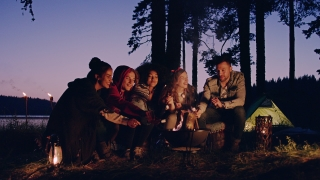 Diverse Group Of Attractive Young People Camping In The Woods At Dusk Eating Marshmallows Laughing And Joking Nature Tourism Romantic Getaway Concept Slow Motion Shot On Red Epic W 8k