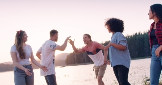 Happy Young Group Of Friends Walking And Laughing On Lake Shore Waving Hands Adventure In The Woods Romantic Getaway Concept Slow Motion Shot On Red Epic W 8k