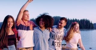 Diverse Group Of Young Men And Women Embracing And Laughing While Walking On Lake Shore Smiling And Pointing Friendship As Lifestyle Happiness In Nature Concept Slow Motion Shot On Red Epic W 8k