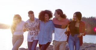 Happy Young Group Of Friends Hugging And Strolling On Lake Shore Talking Vacation In Nature Travel Party Concept Slow Motion Shot On Red Epic W 8k