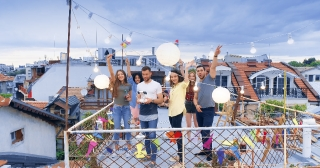 Drone Flight Over Rooftop Diverse Young Party People Cheerful Partying Relaxing Hipster Culture Urban Relaxation Concept During Beautiful Urban Sunset