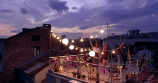 Flight Over New Year Celebration Rooftop Party Cheerful Partying Holding Sparkler Fire Fourth Of July Celebration Freedom To Enjoy Life Concept At New Years Eve