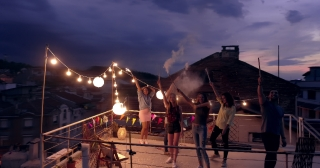 Drone Flight Over Rooftop Diverse Young Party People Waving At Drone Holding Sparkler Fire New Years Eve Party Festive Time Happy Event Concept During Beautiful Urban Night