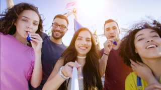 Festive Group Of Beautiful Diverse Young Friends Taking A Pickture Using A Selfie Stick Smiling Festive Celebration Togetherness Concept At Sunset Shot on Red Epic W 8K Slow Motion