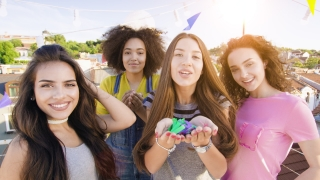 Group Of Diverse Teen Friends Blowing Confetti At Camera Looking Joyful Excited Youth Party People Urban Festival Concept During Golden Hour Shot on Red Epic W 8K Slow Motion