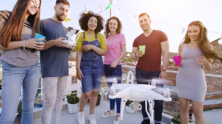 Young People At Celebration Rooftop Party Flying Uav Quadcopter Smiling Happy Fun Time Festive Time Happy Technology Event Event Concept At Dusk Shot on Red Epic W 8K Slow Motion