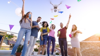 Young People At Celebration Rooftop Party Flying Uav Quadcopter Smiling Surprised Fourth Of July Celebration Social Networking Concept During Golden Hour Shot on Red Epic W 8K Slow Motion