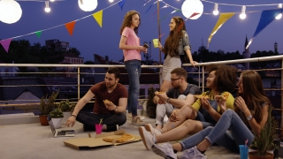 Young Friendly People At Celebration Rooftop Party Listening To Music Playing Enjoying Pizza And Cocktails Outside Happy Music Celebration Occasion Of Friendship Carefree Friendship Cheerful Music Lif