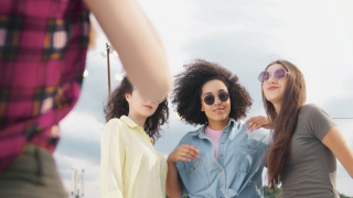 Diverse Young Party Girls On Rooftop Posing As Young Female Photographer Takes Pictures Of Them Fashion Photography Happy Music Celebration Occasion Of Friendship Photoshoot Carefree Friendship Cheerf