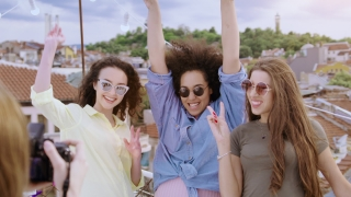 Group Of Diverse Teen Girls On Rooftop Smiling And Posing Taking Pictures With Dslr Camera Fashion Photography Festive Photoshoot Party Carefree Friendship Cheerful Artsy Lifestyle Concept After Sunse