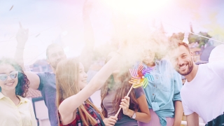 Diverse Group Of Young Hipsters Friends On Rooftop Celebrating In Colorful Smoke Laughing And Dancing In Confetti Relaxation And Joy Togetherness Concept During Beautiful Urban Sunset Shot on Red Epic