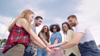 Festive Group Of Diverse Pretty Young Friends Standing In A Circle High Five Celebrating Victory And Teamwork Success And Colaboration Fun Time At Party Carefree Friendship Cheerful Artsy Lifestyle Co