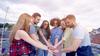 Diverse Group Of Young Hipsters Friends On Rooftop Standing In Circle Raising Hands Celebrating Successful Teamwork Success And Colaboration Fun Time At Party Carefree Friendship Cheerful Artsy Lifest