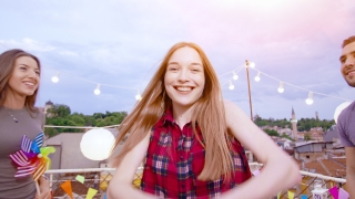 Beautiful Teen Girl Walking Through Confetti Fall As People Cheer And Celebrate Jumping And Laughing Relaxation And Joy Birthday Celebration At Sunset Shot on Red Epic W 8K Slow Motion