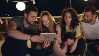 Diverse Young Party Friends On Rooftop Looking At A Tablet Smiling And Sharing Funny Internet Videos Looking At A Project Together Teamwork Technology Ar Party 3g 4g 5g Future Communication Technology