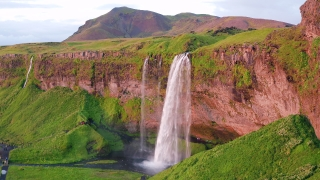 Epic Drone Shot Around Famous Waterfall In Iceland Water Flowing Through High Cliffs Inspiration Epic Scale Nature Sight Seeing