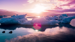 Aerial Flight Floating Arctic Ice Melting In A Beautiful Ice Lake Majestic Sunset Climate Crisis Epic Adventure