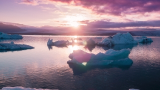 Epic Aerial Flyover Floating Arctic Ice Melting In A Beautiful Ice Lake Purple Sunset North Pole Extreme Adventure Concept