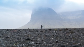 Aerial Flight Toward Man Walking in Iceland Nordic Mountain Landscape Fog Rain Young Earth Environment Epic Scale Confidence Dacing Problems Loneliness Depression Conept