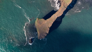 Epic Aerial Flyover Over Rock Formations Shore Iceland Black Sand Majestic Nature Ice Caps Spirituality