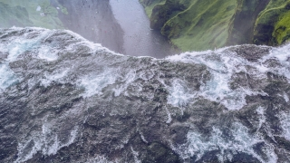 Epic Aerial Flight Around Famous Waterfall In Iceland Water Flowing Through High Cliffs Inspiration Epic Scale Nature Epic Adventure