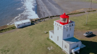 Epic Aerial Flyover Around Lighthouse on Cliff Shore Iceland Black Sand Nature Beauty Climate Change Epic Beauty