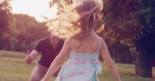 Little Girl Running And Embracing Her Father At Sunset In The Park Family Love Happiness Children Concept Slow Motion Shot On Red Epic 8K