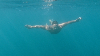 Atheltic Young Man Swimming in The Ocean Slow Motion Underwater Shot Holiday Leisure Red Epic 8k