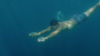 Atheltic Young Man Swimming in The Ocean Slow Motion Underwater Shot Freedom Athlette Red Epic 8k