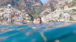 Young Man Swimming in the Ocean on Holliday in Italy Travel Adventure Vacation Adventure Concept Shot Red Epic 8k